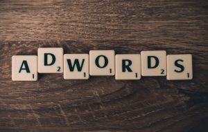 "The letters ""adwords"" showing more services offered than just search engine optimization."