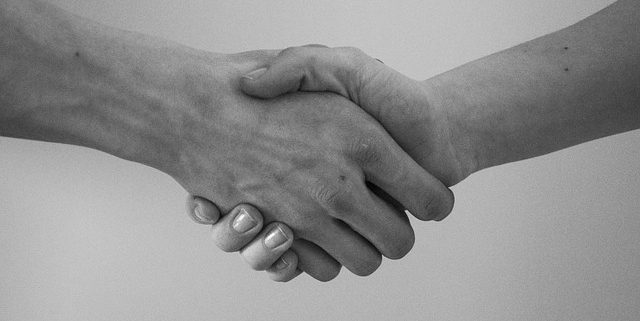 Signing a search engine optimization contract with a hand shake